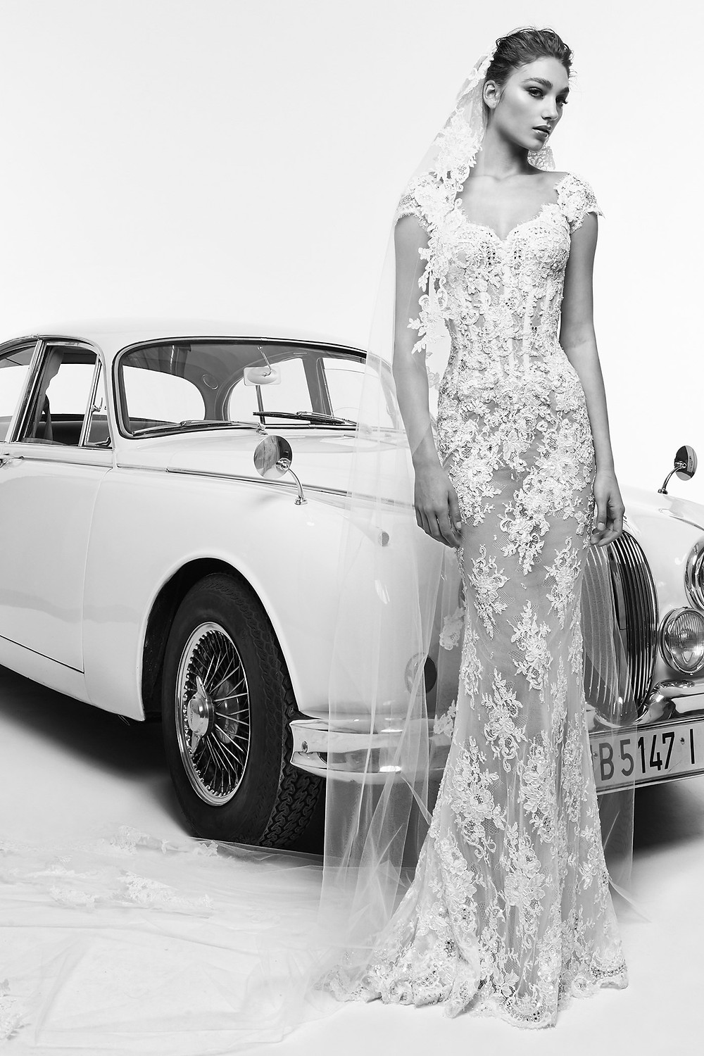 A Zuhair Murad lace and mesh mermaid fit and flare wedding dress with cap sleeves