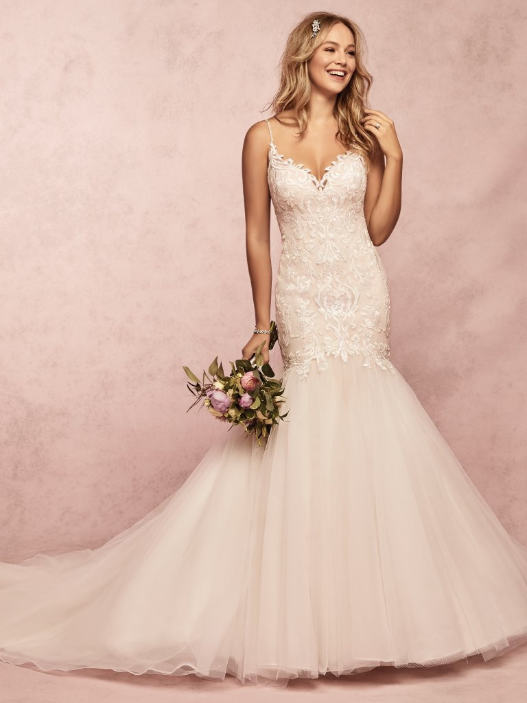 A blush, mermaid wedding gown, with tulle skirt, lace and straps