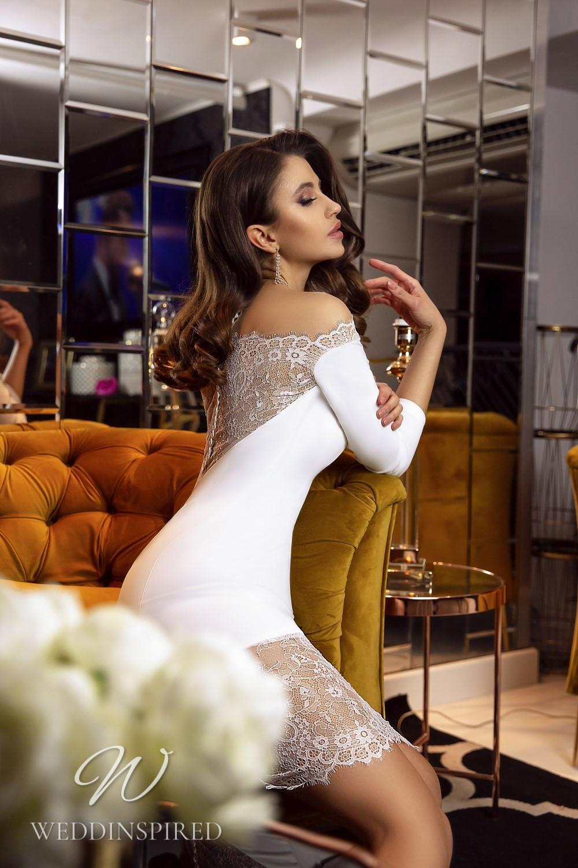 A Tina Valerdi short off the shoulder wedding dress