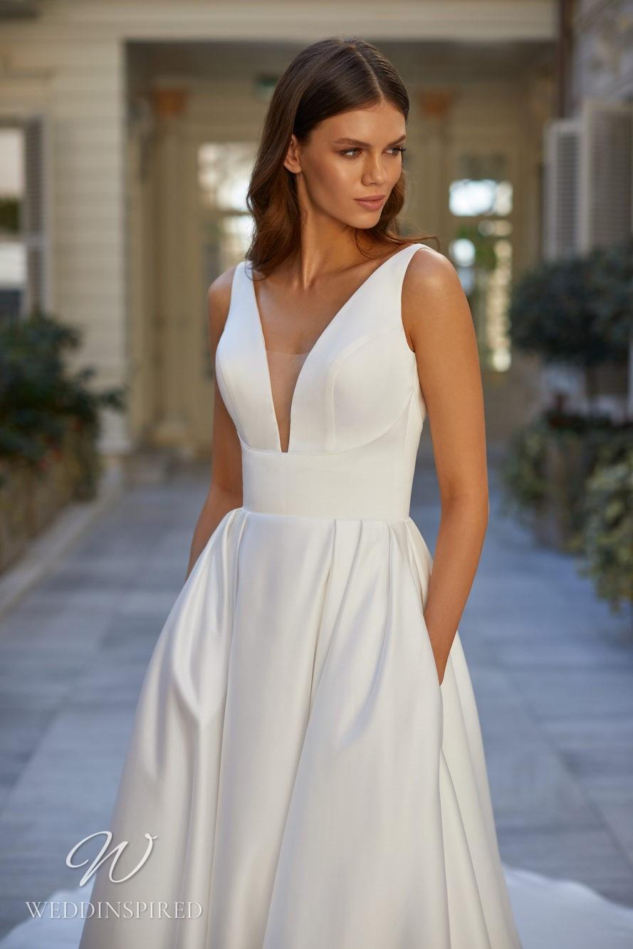 A Milla Nova 2021 simple satin A-line wedding dress with pockets, a v neck and straps