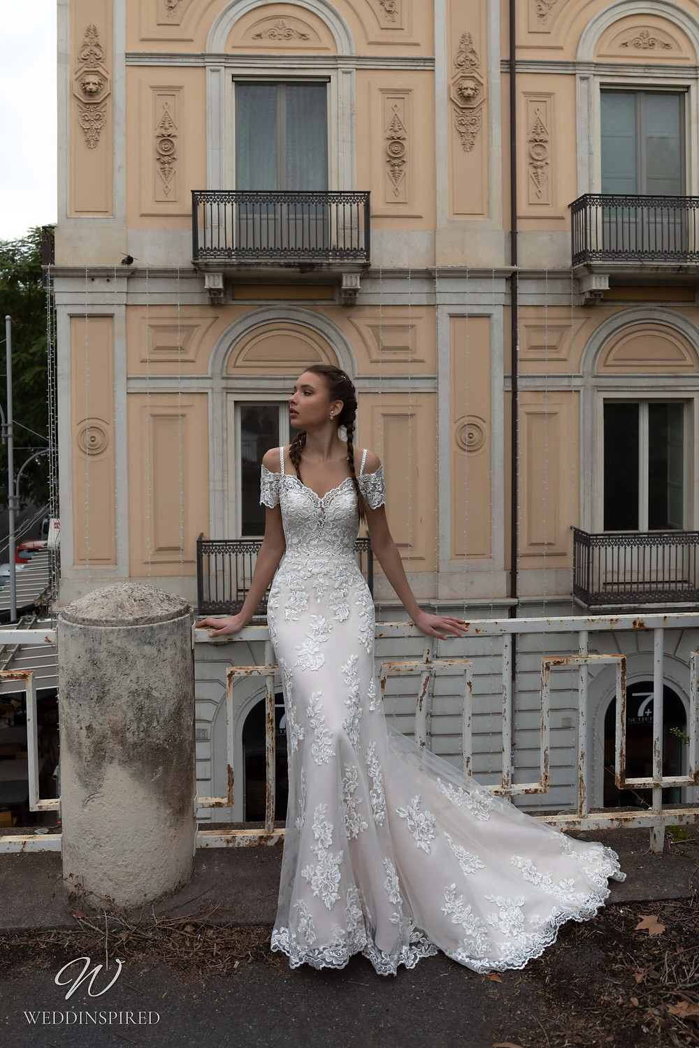 A Naviblue lace off the shoulder mermaid wedding dress with cap sleeves