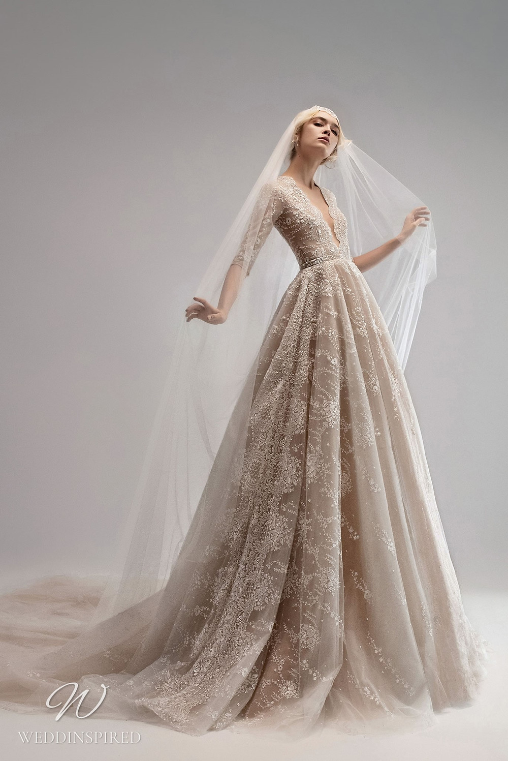 An Ersa Atelier 2021 blush ball gown wedding dress with a tulle skirt, half sleeves and beading