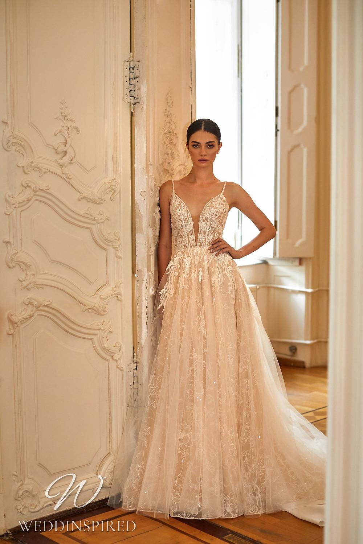 A Daria Karlozi 2021 blush tulle A-line wedding dress