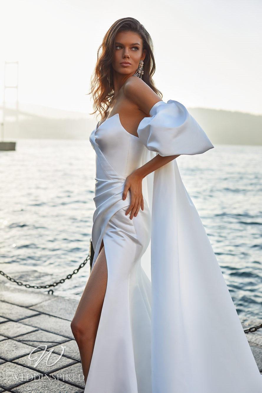 A Milla Nova 2021 strapless satin mermaid wedding dress with a high slit