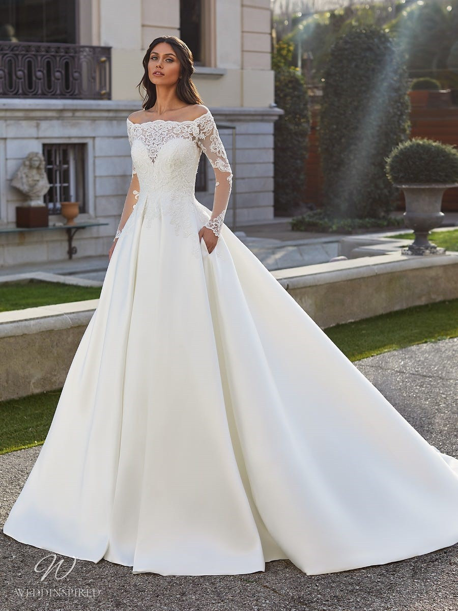 A Pronovias 2021 lace and silk off the shoulder ball gown wedding dress with long illusion sleeves