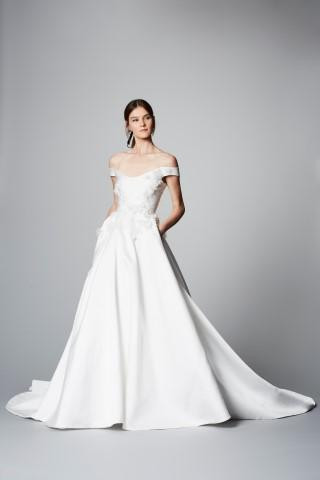 A Marchesa simple off the shoulder crepe ball gown wedding dress with pockets