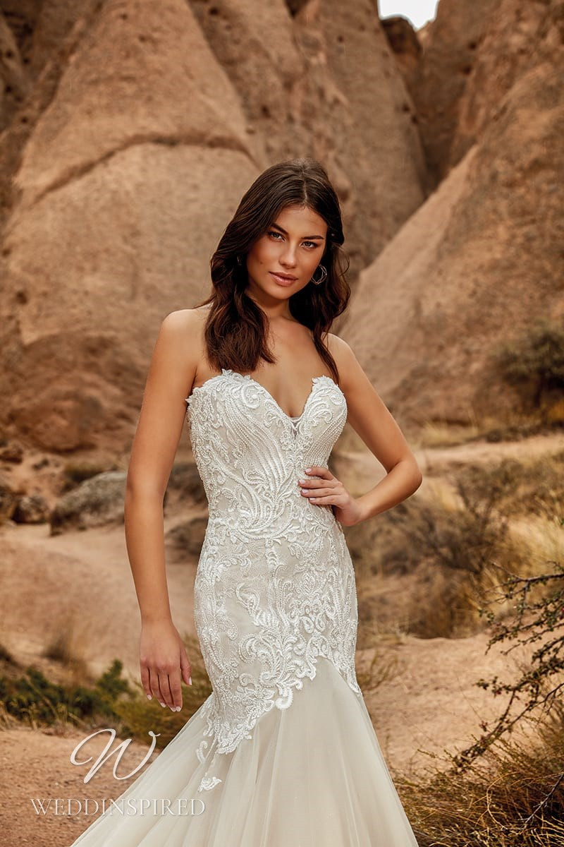An Eddy K 2021 strapless lace and tulle mermaid wedding dress