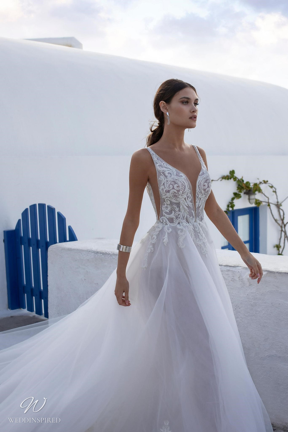 A Ricca Sposa tulle A-line wedding dress with straps and a deep v neckline