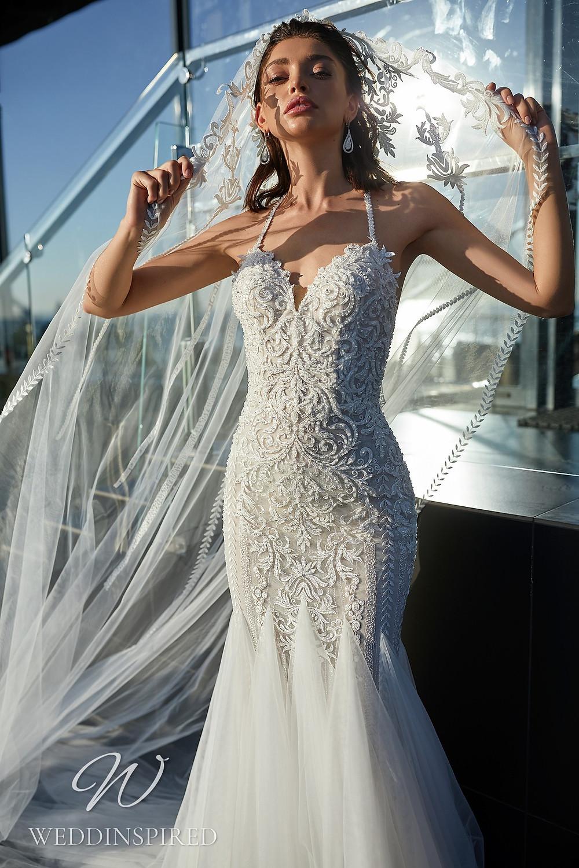 An Ida Torez 2021 lace and tulle mermaid wedding dress