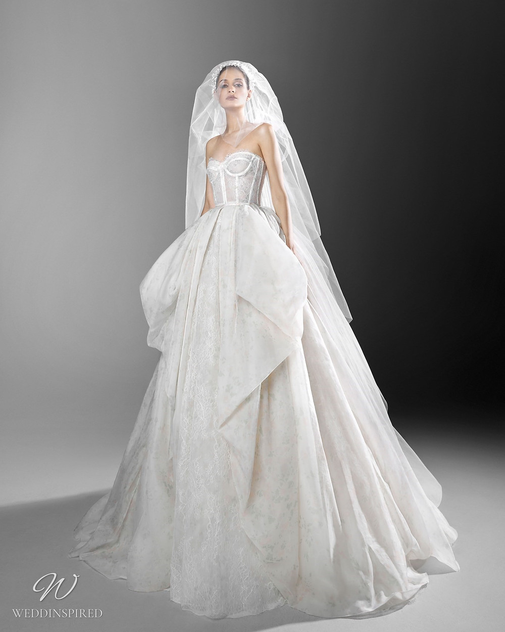 A Zuhair Murad white princess ball gown wedding dress with a sweetheart neckline and bustier top