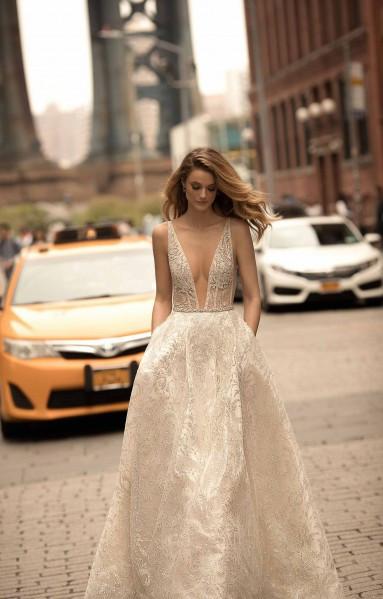 A Berta ivory A-line wedding dress with pockets and a v neckline
