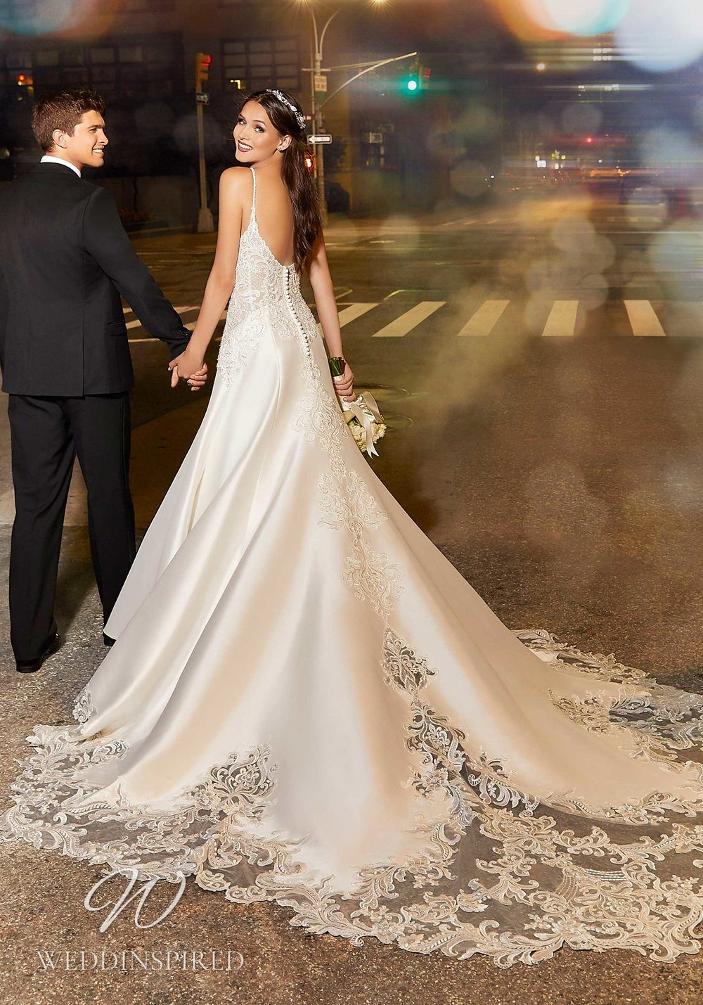 A Madeline Gardner lace and satin A-line wedding dress with straps