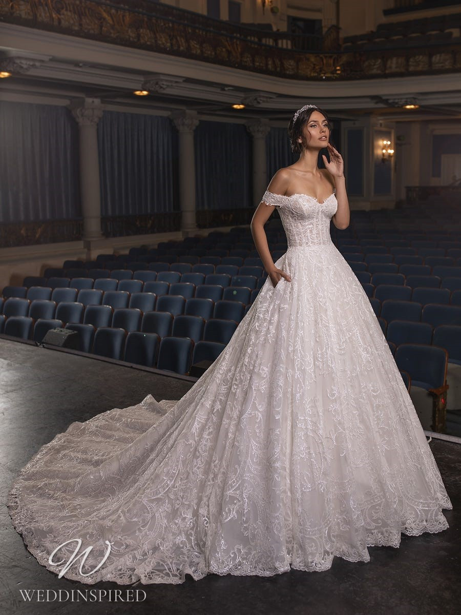 A Pronovias Privée 2021 lace off the shoulder princess ball gown wedding dress with a train