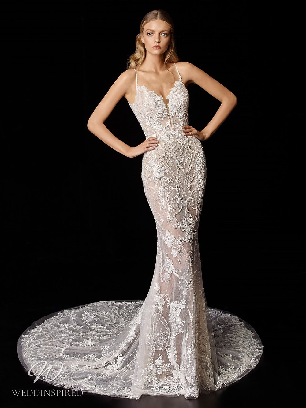 An Enzoani lace mermaid wedding dress with thin straps and a train