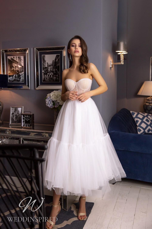 A Tina Valerdi strapless tulle tea length wedding dress