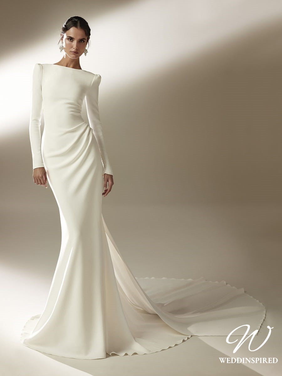An Atelier Pronovias modest long sleeve silk mermaid wedding dress with a train