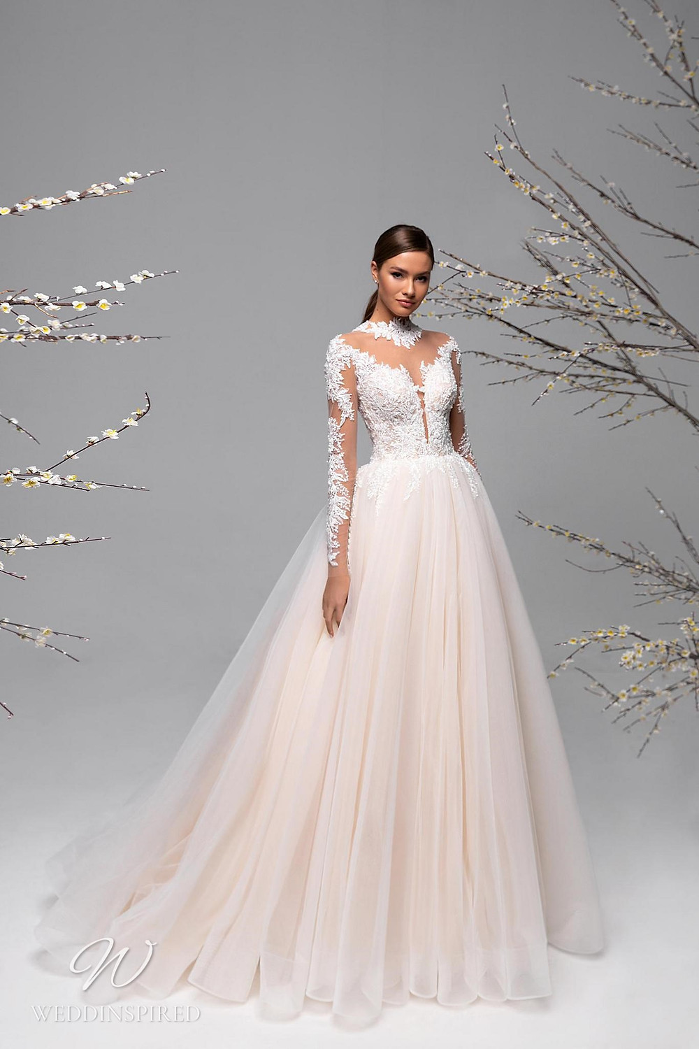 A Ricca Sposa blush lace and tulle ball gown wedding dress with long illusion sleeves