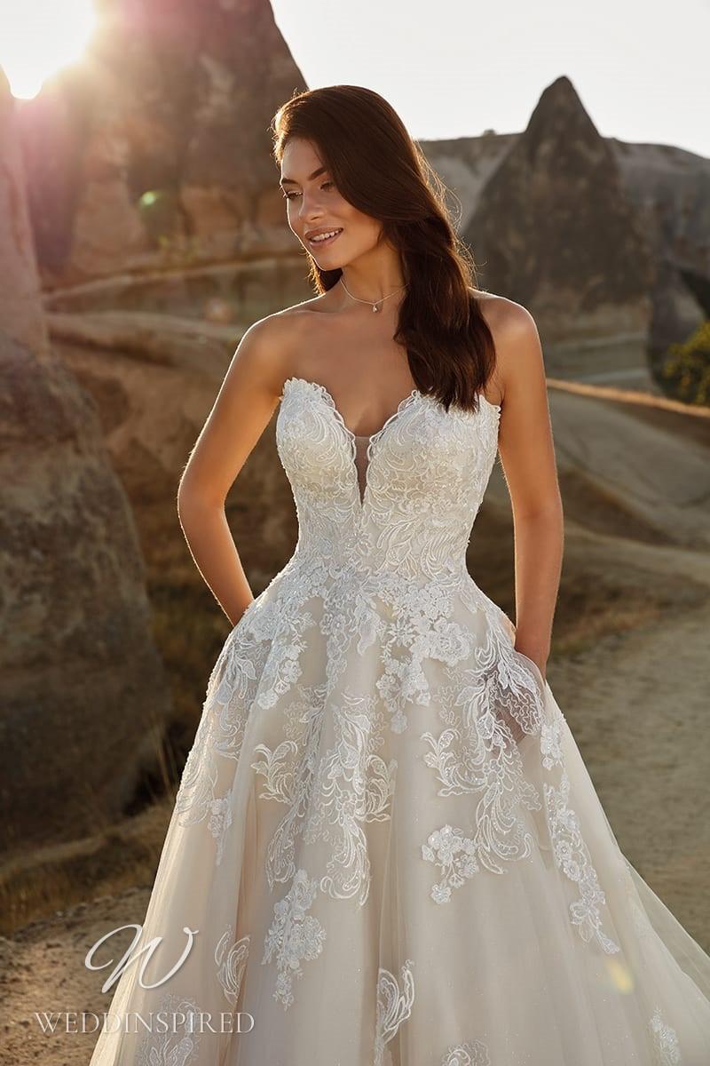 An Eddy K 2021 strapless lace A-line wedding dress