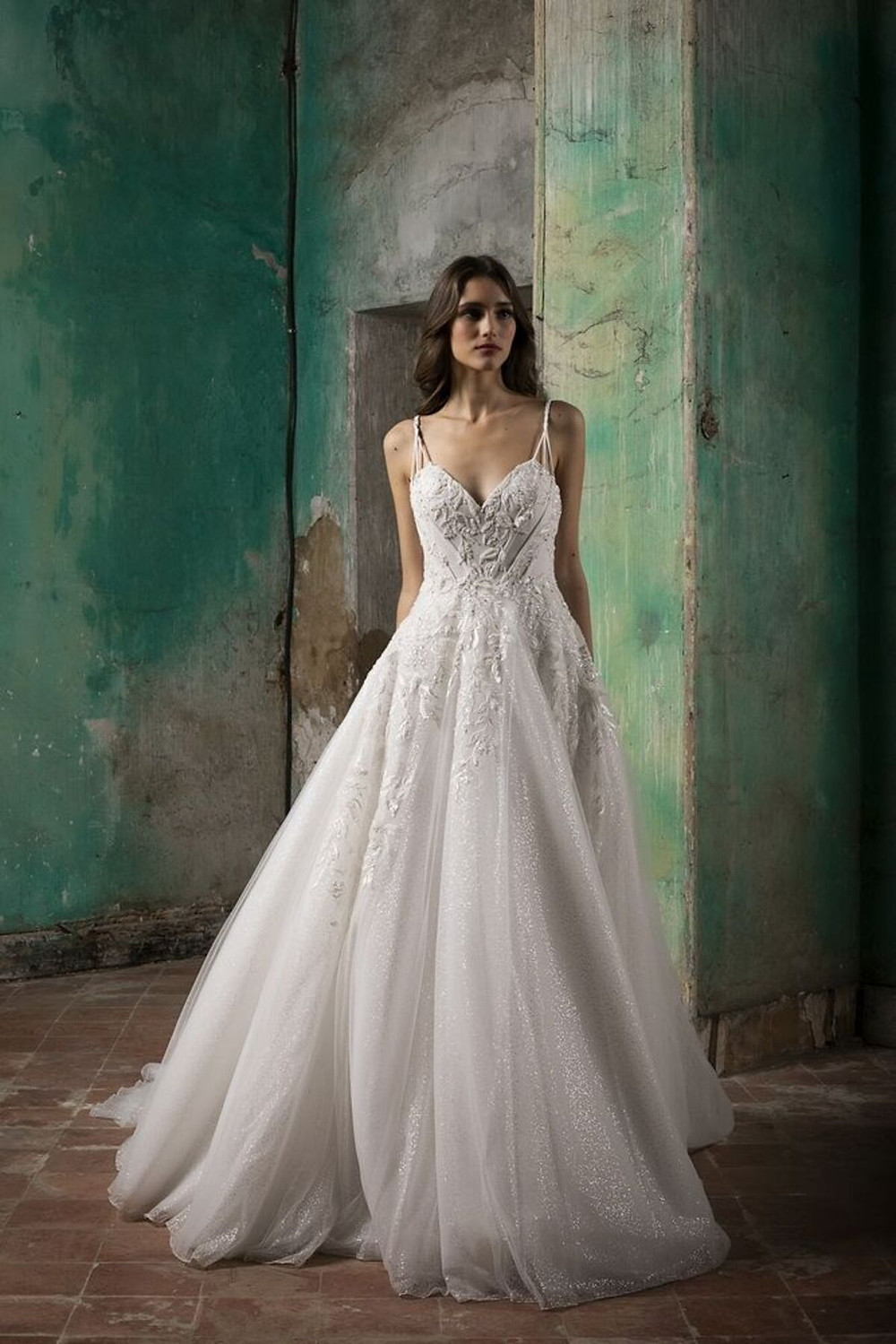 A voluminous wedding gown featuring floral embroideries finished with sequin detailing