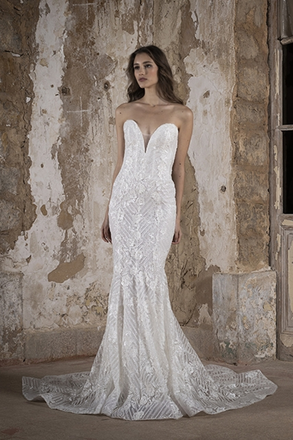 A mermaid shaped wedding gown with floral embroidery and sequin detailing