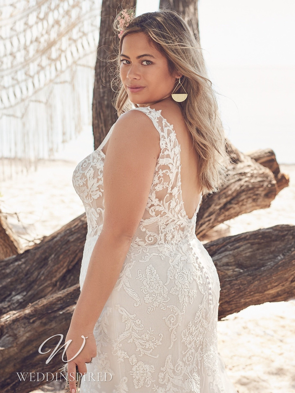 A Rebecca Ingram 2021 plus size lace mermaid wedding dress with a low back