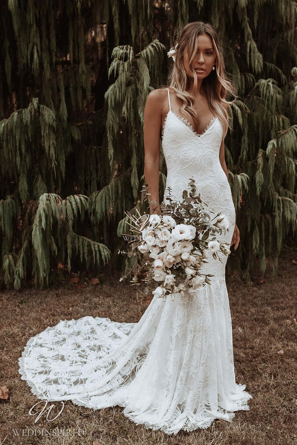 A Grace Loves Lace mermaid lace wedding dress with a train, thin spaghetti straps and a v neck