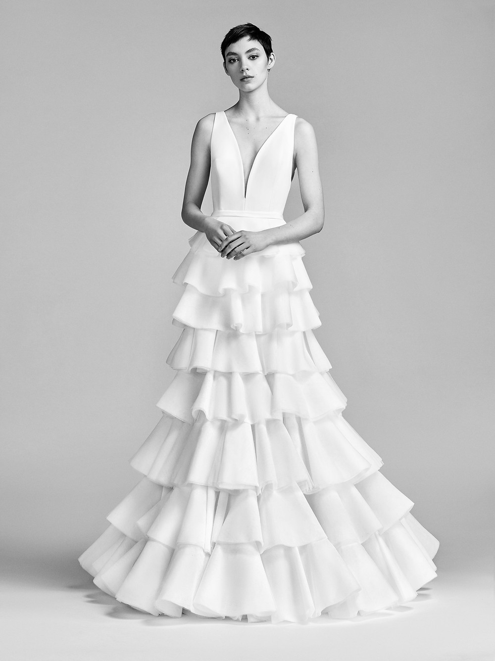 A Viktor & Rolf A-line wedding dress with a layered ruffle skirt and straps