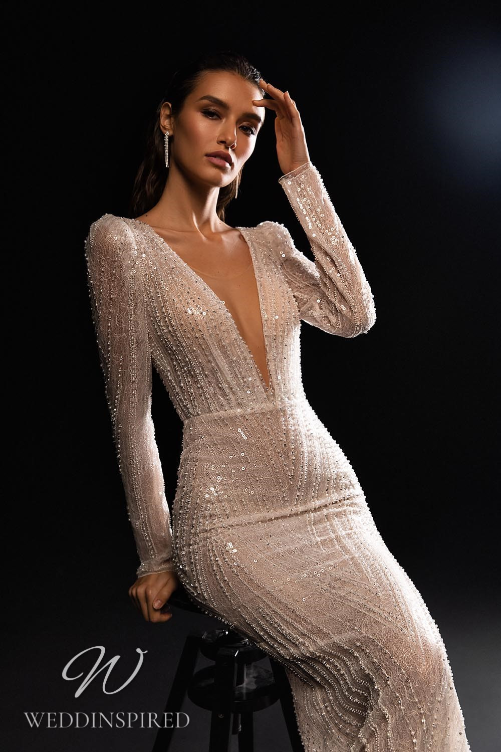 A WONÁ Concept 2021 sparkly mermaid wedding dress with long sleeves and a v neck