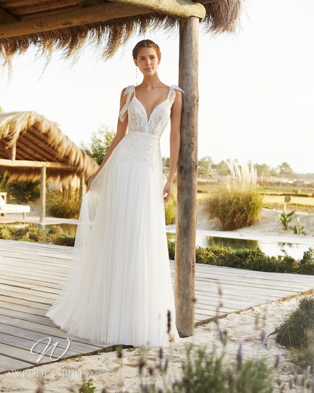 An Aire Barcelona 2021 flowy lace and tulle A-line wedding dress