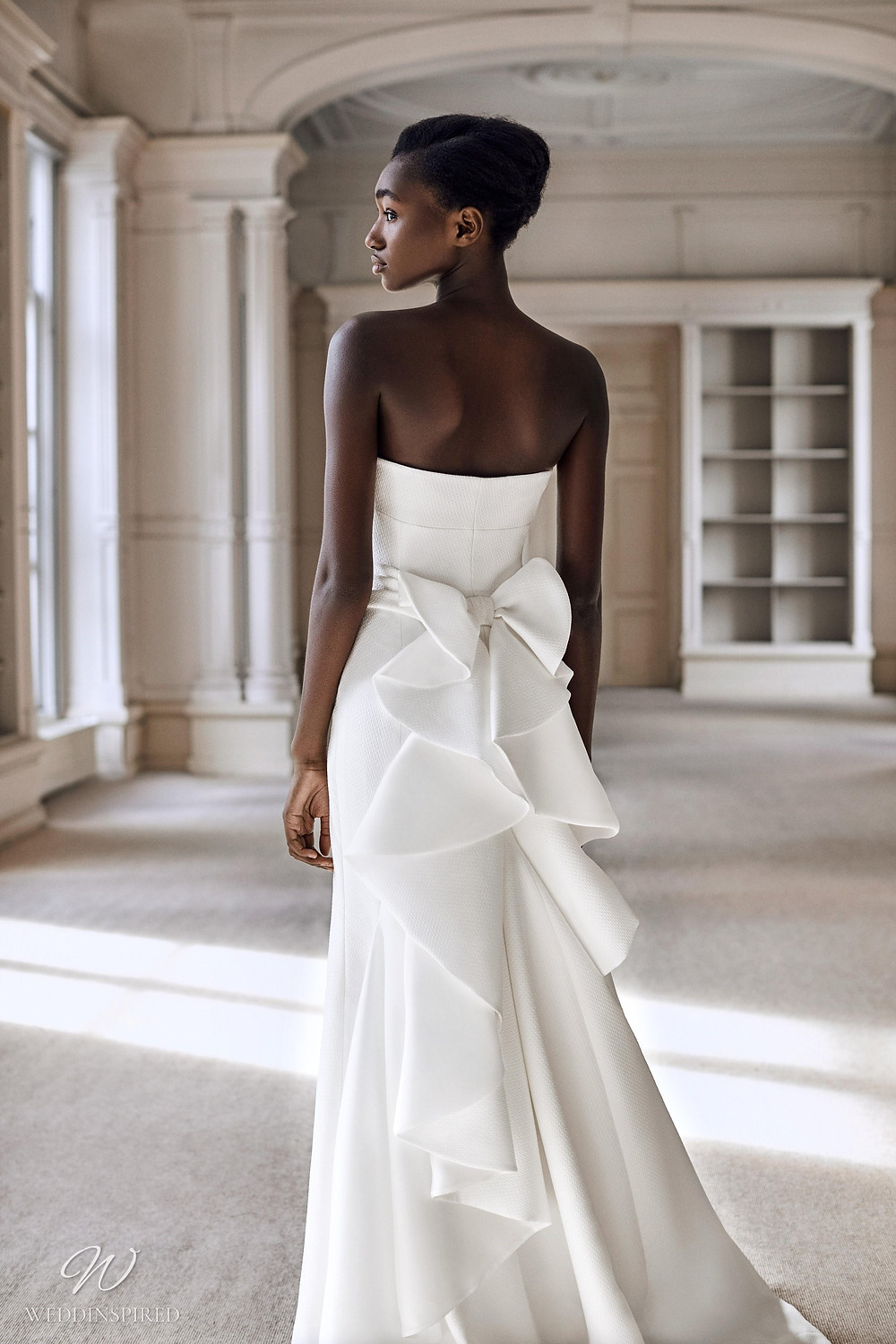 A Viktor & Rolf 2021 A-line wedding dress with bows and ruffles