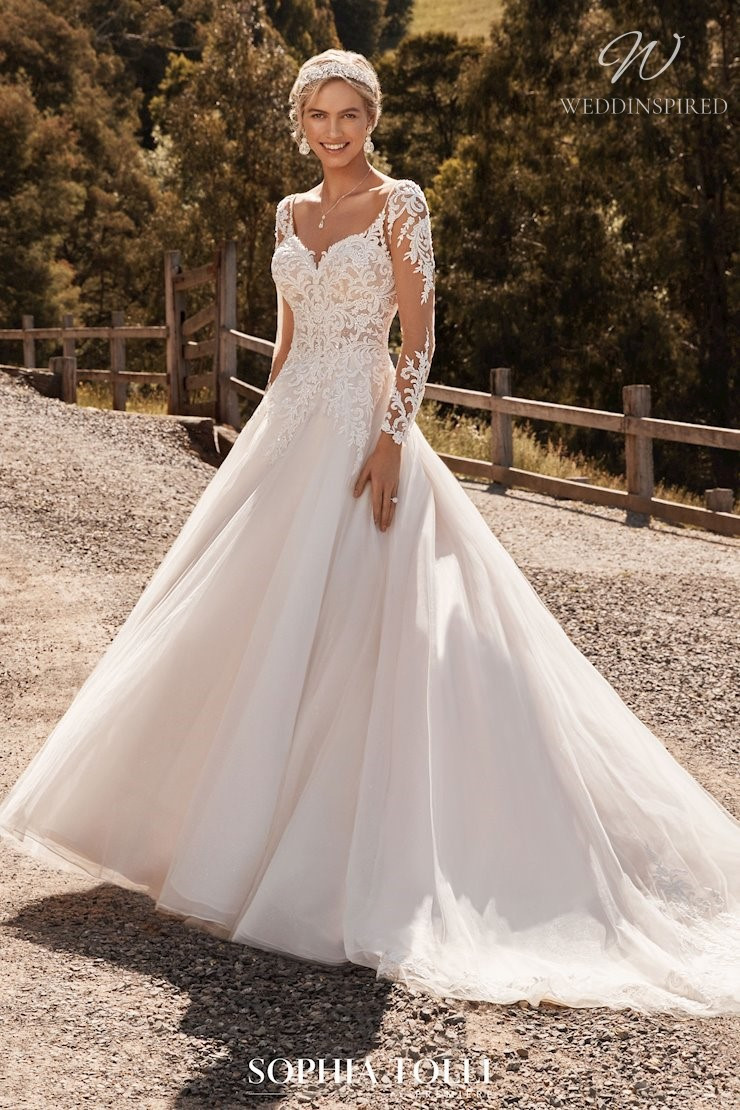 A Sophia Tolli lace and tulle ball gown wedding dress with sleeves