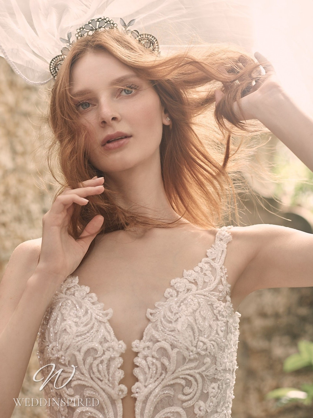 A Maggie Sottero Spring 2021 lace mermaid wedding dress with straps and a v neck