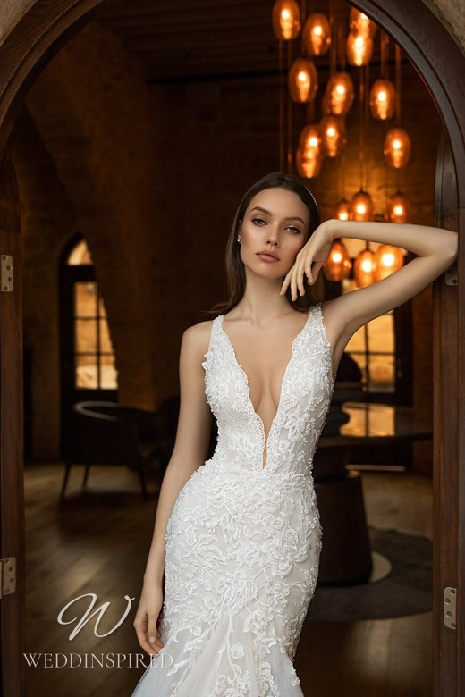 An Ida Torez 2021 lace and tulle mermaid wedding dress with a deep v neckline