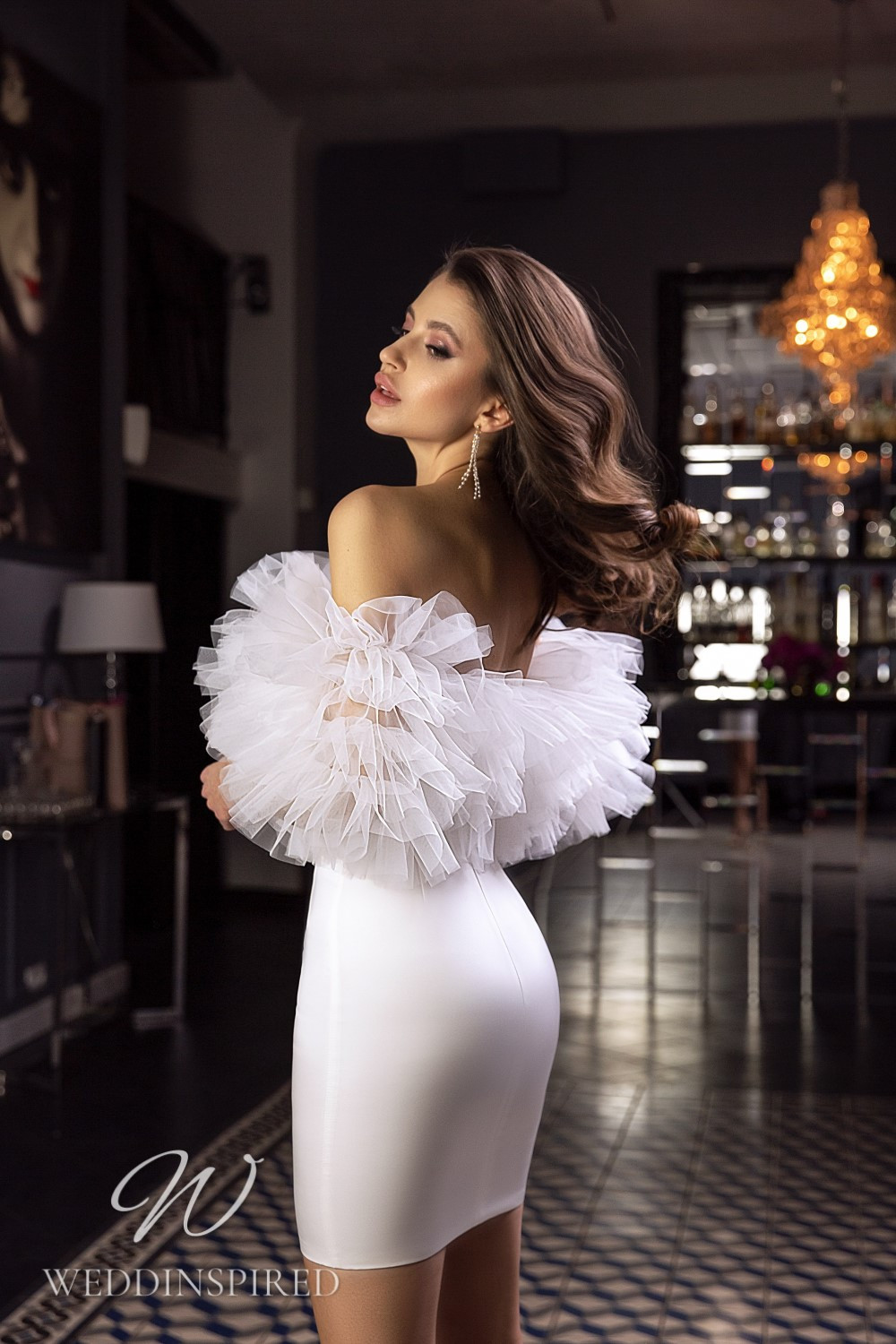 A Tina Valerdi satin and tulle off the shoulder short wedding dress with a ruffle top