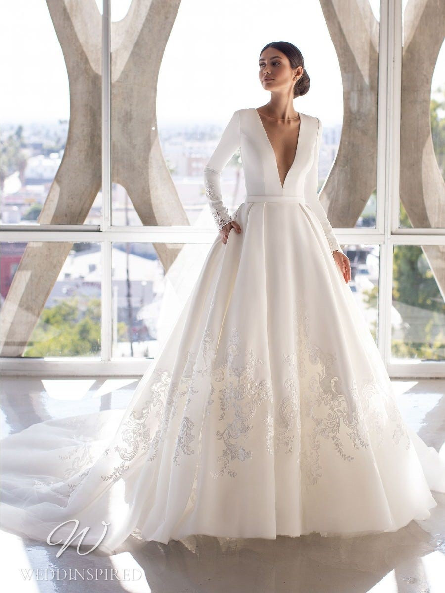 A Pronovias 2021 satin ball gown wedding dress with long sleeves, pockets and a v neck