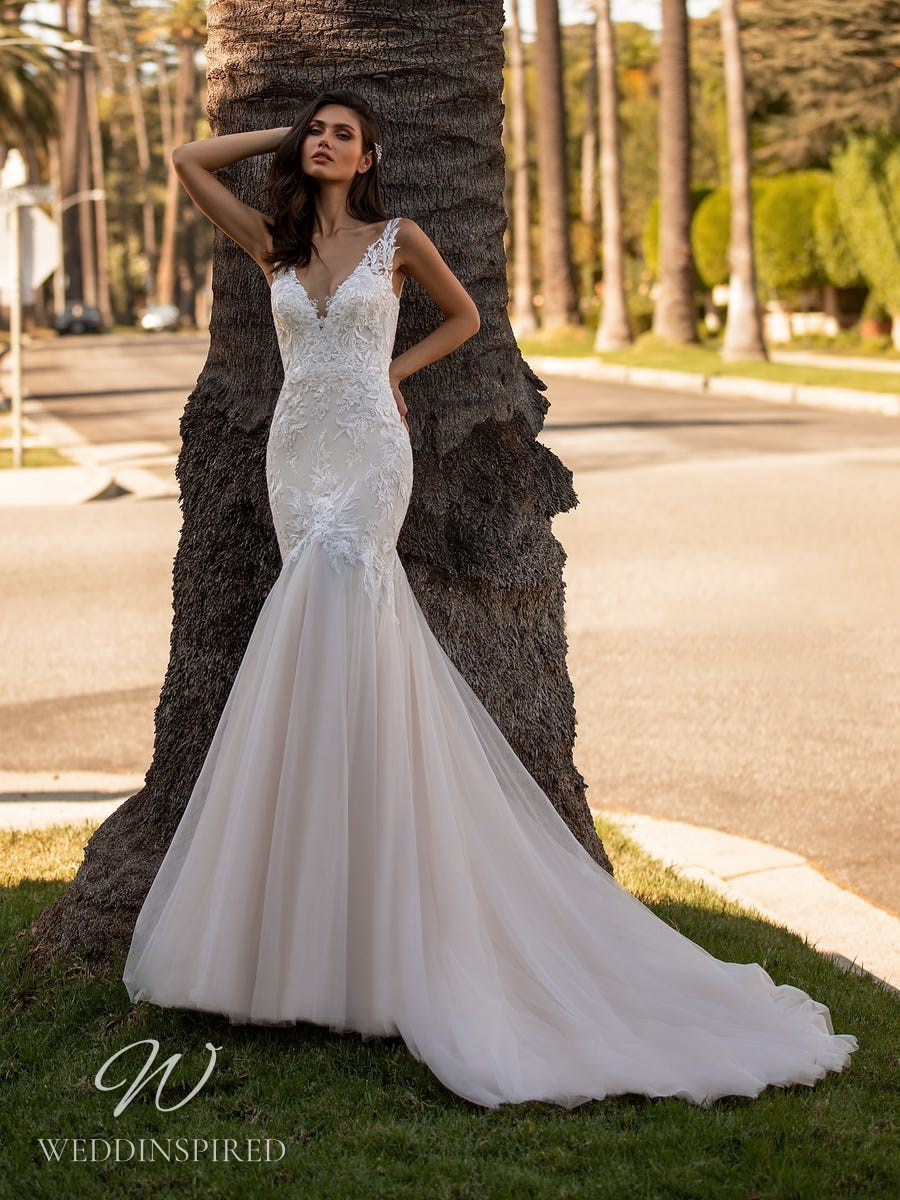 A Pronovias 2021 lace and tulle mermaid wedding dress with straps and a v neck