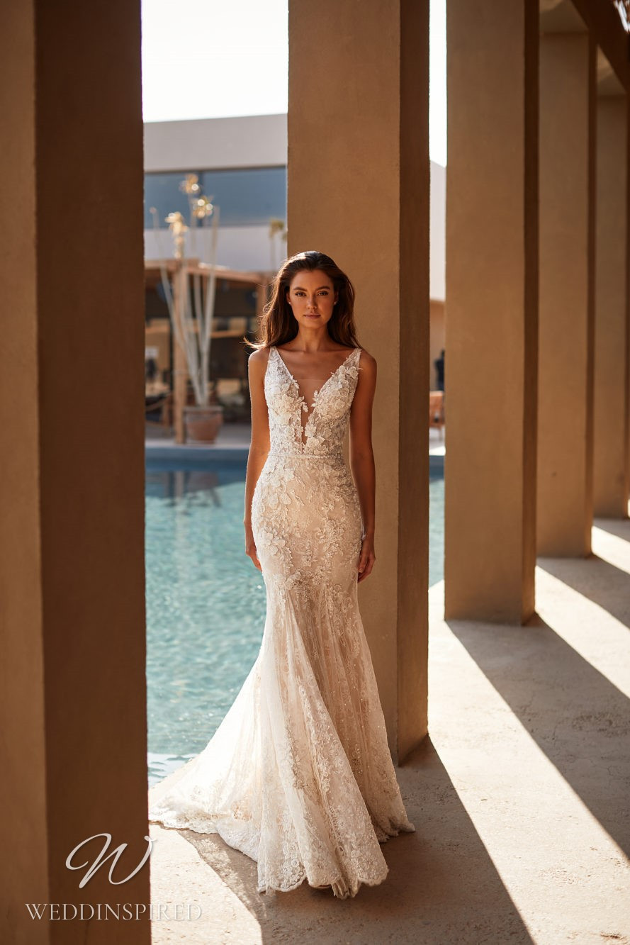 A Milla by Lorenzo Rossi 2021/2022 lace mermaid wedding dress with straps and a v neck
