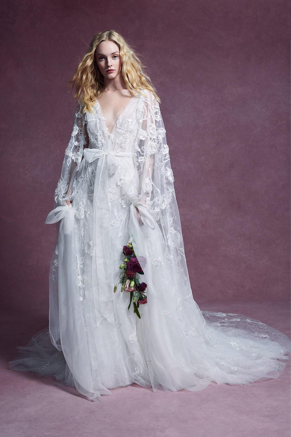 A Marchesa 2020 sheath style, tulle wedding dress that is long and flowy and has flowers and embroidery