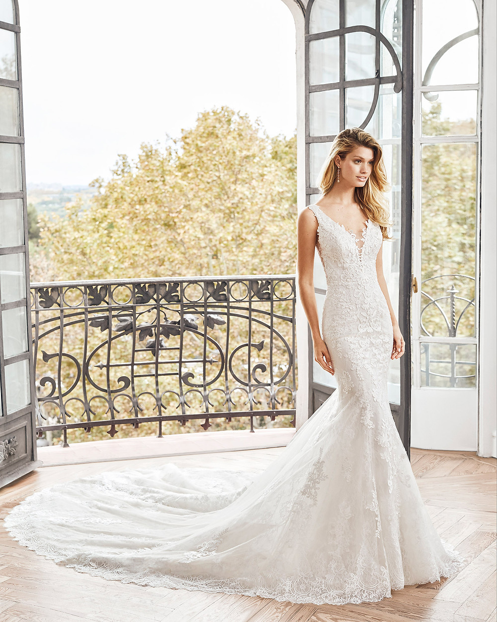 An Aire Barcelona 2020 romantic lace mermaid fit and flare wedding dress with a v neckline