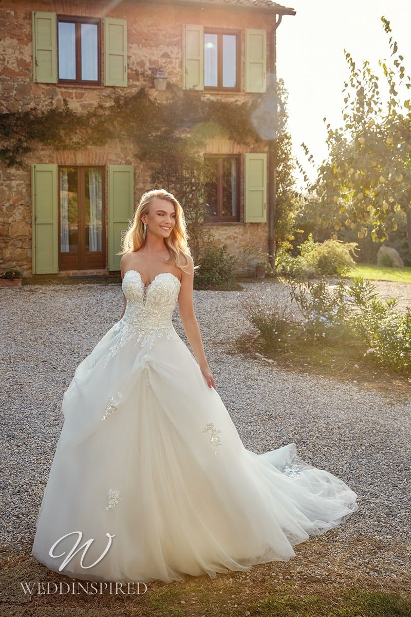 An Eddy K 2021 strapless lace and tulle princess ball gown wedding dress