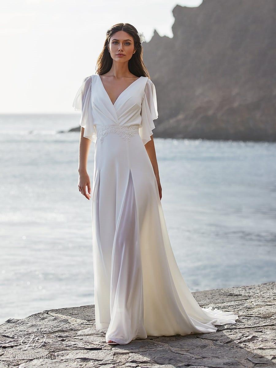 A Pronovias 2021 simple flowy chiffon A-line wedding dress with a v neckline and flowy sleeves