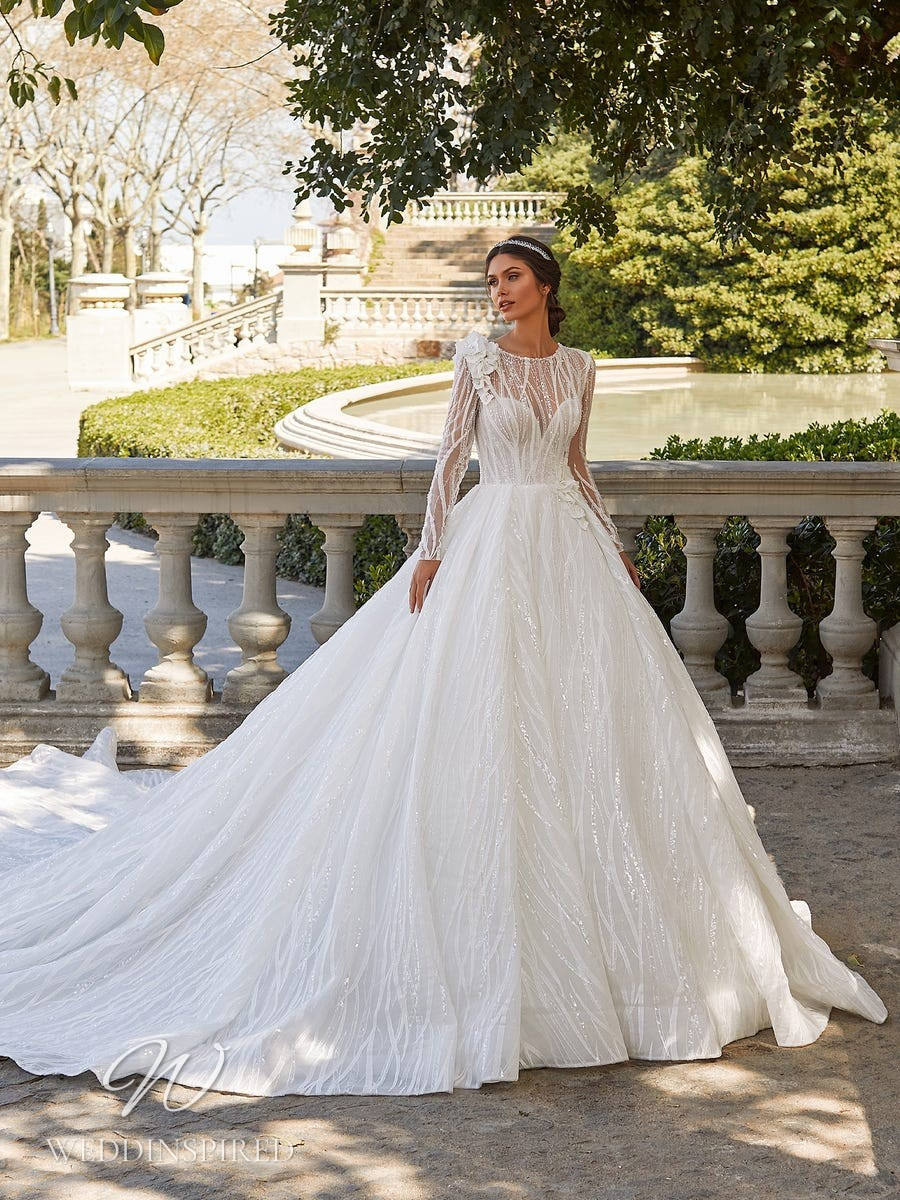 A Pronovias Privée 2021 sparkly princess ball gown wedding dress with long sleeves and a train
