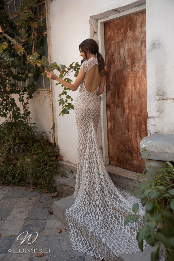 An Eden Aharon 2020 lace mermaid wedding dress with a high neckline, cap sleeves and a low back