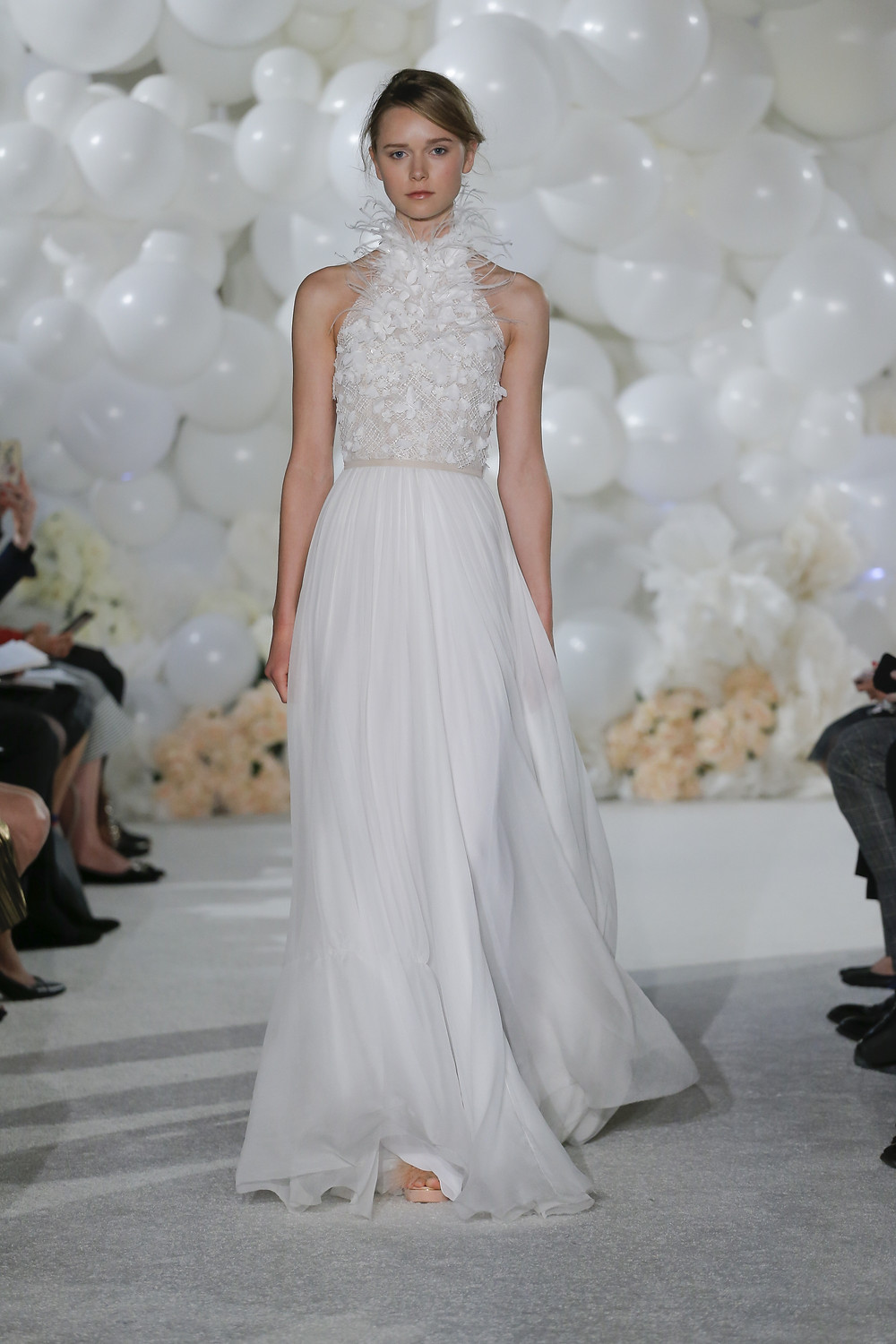 A Mira Zwillinger flowy chiffon and feathers A-line wedding dress