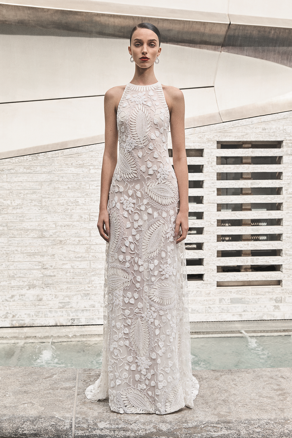 A Naeem Khan halterneck lace column wedding dress