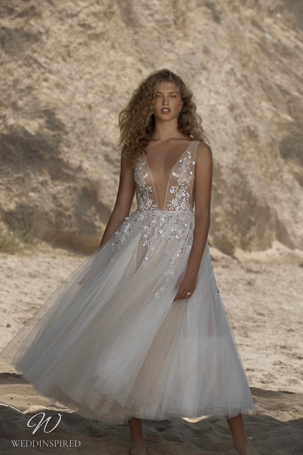 A Muse by Berta mesh and tulle tea length short wedding dress with straps and a v neck