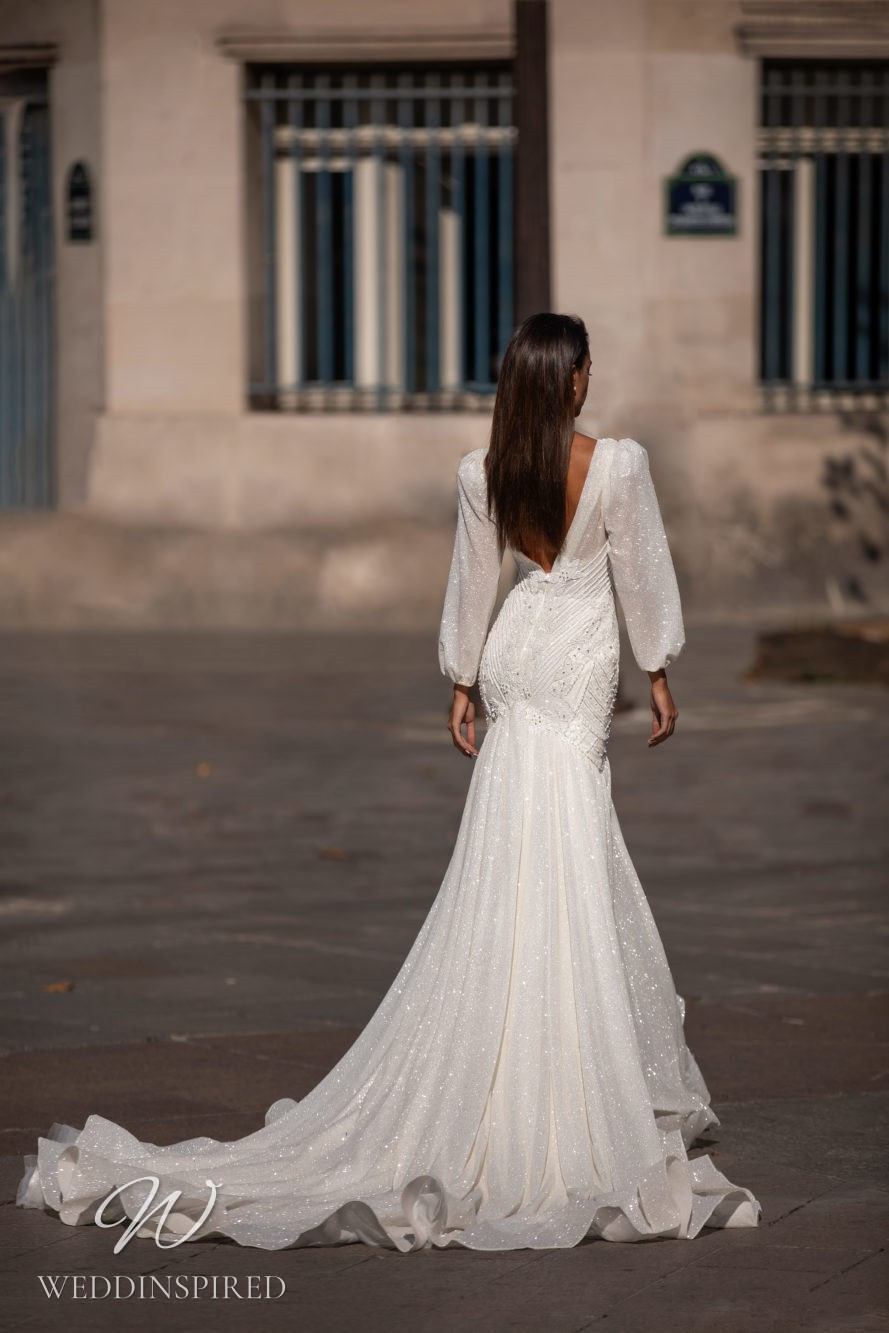 A Milla Nova sequin trumpet wedding dress with a low back and long puff sleeves