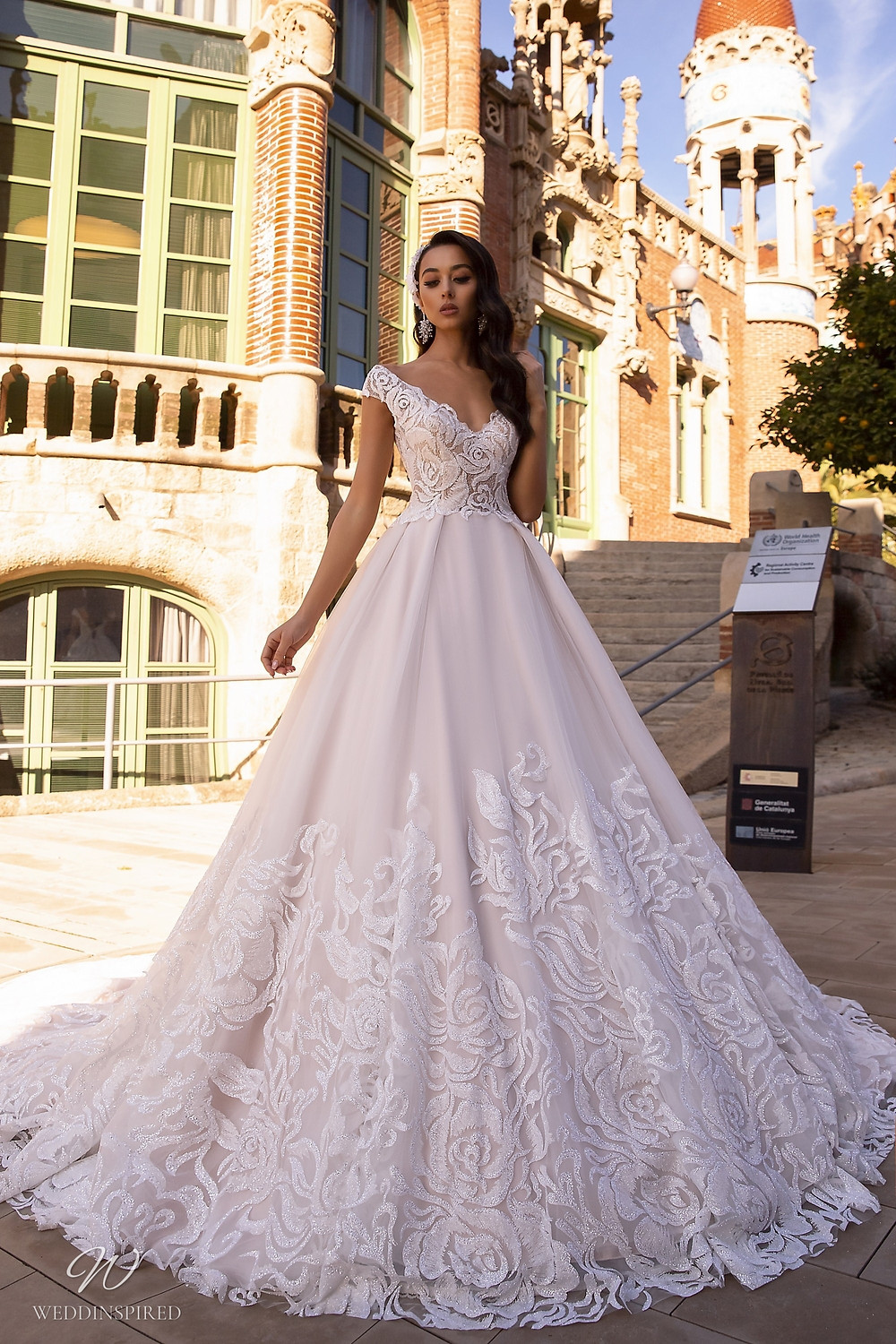 A Maks Mariano off the shoulder blush princess ball gown wedding dress