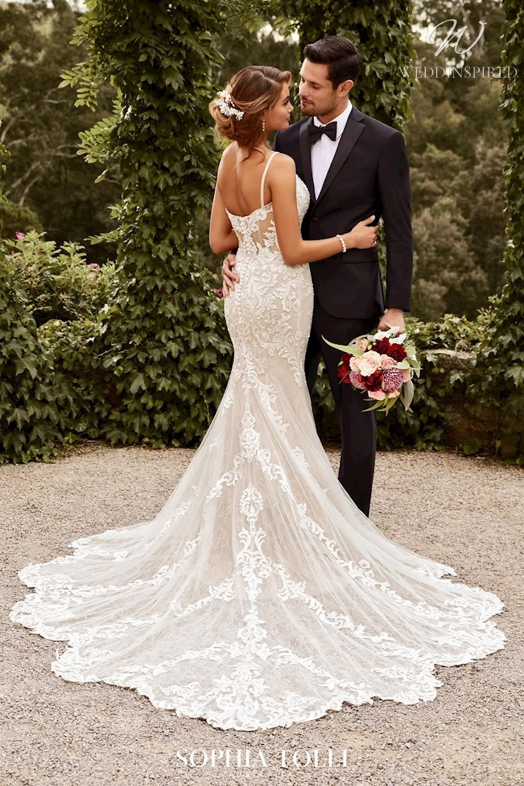 A Sophia Tolli lace and tulle mermaid wedding dress with a train
