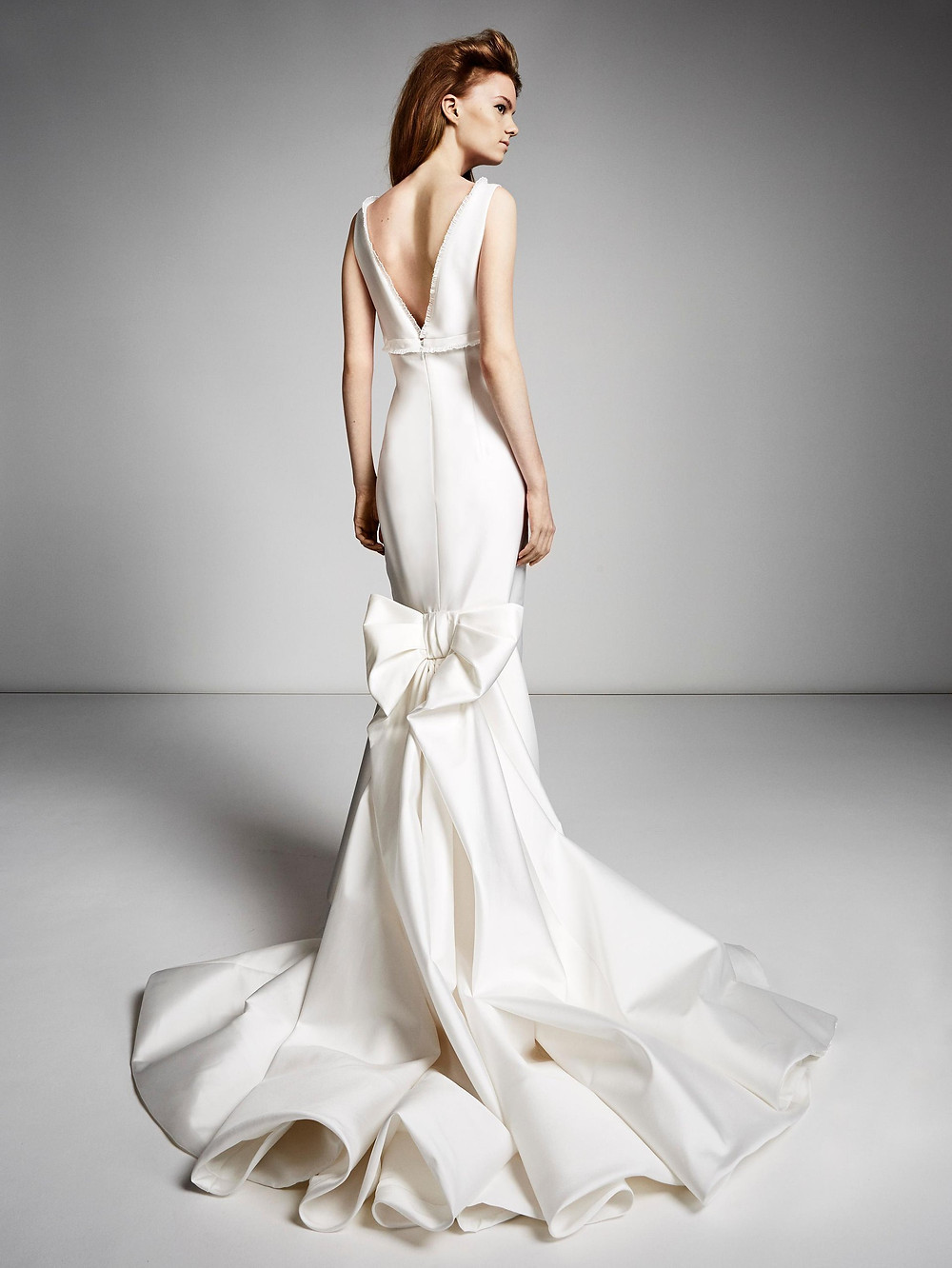 A Viktor & Rolf simple silk mermaid fit and flare wedding dress with a bow